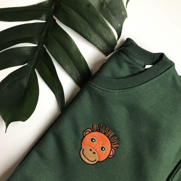 Tommy & Lottie Organic Cotton Orangutan Sweatshirt - flay lay - bottle green