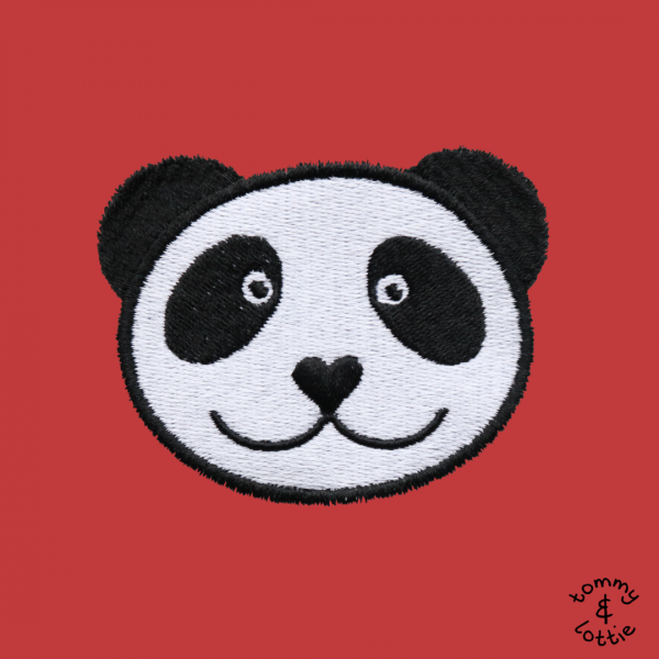 tommy & lottie close up of panda embroidery design